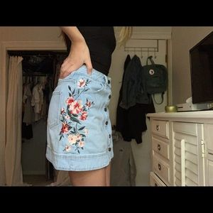 Pacsun denim skirt with embroidered flowers.